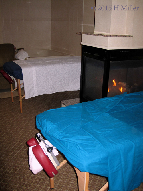 Couples Massage By The Warm Fireplace on A Cold Snowy Day