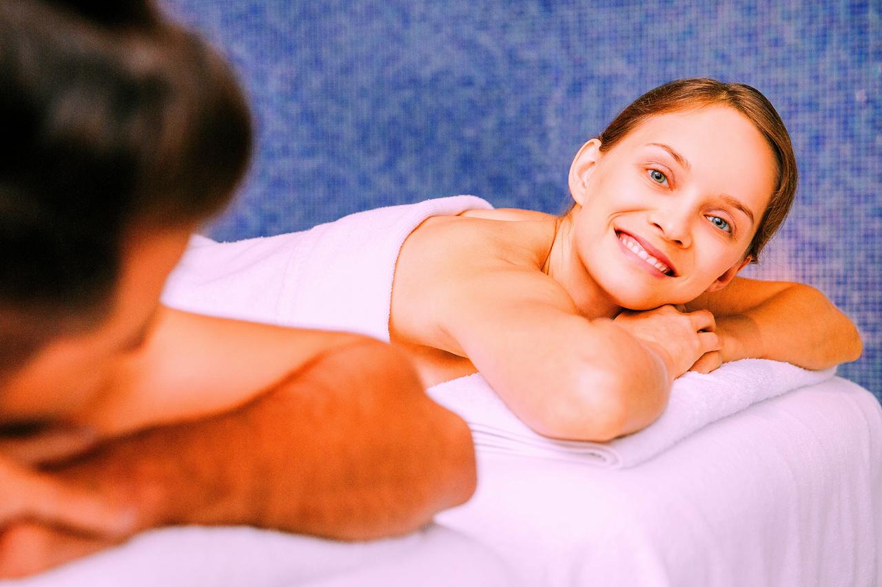 Couples Massgae. Woman Smiling At Camera.